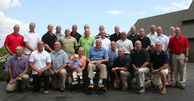Picture of secret service agents and George H W Bush with shaved heads showing support for Patrick's Pals