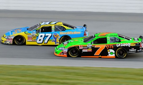 Picture of HostGator race car driving beside Go-Daddy race car
