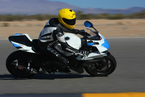 Fused CEO David Mckendrick racing motorcycle at racetrack
